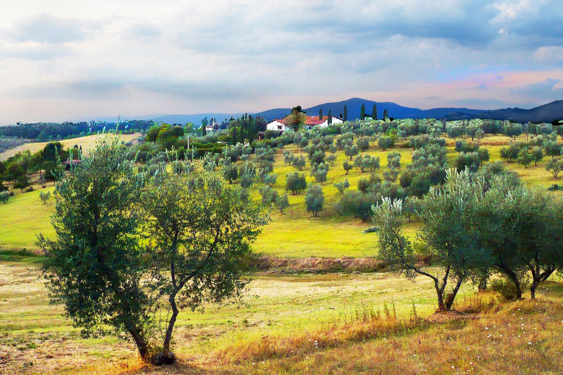 Propriété dans la campagne toscane avec des terres